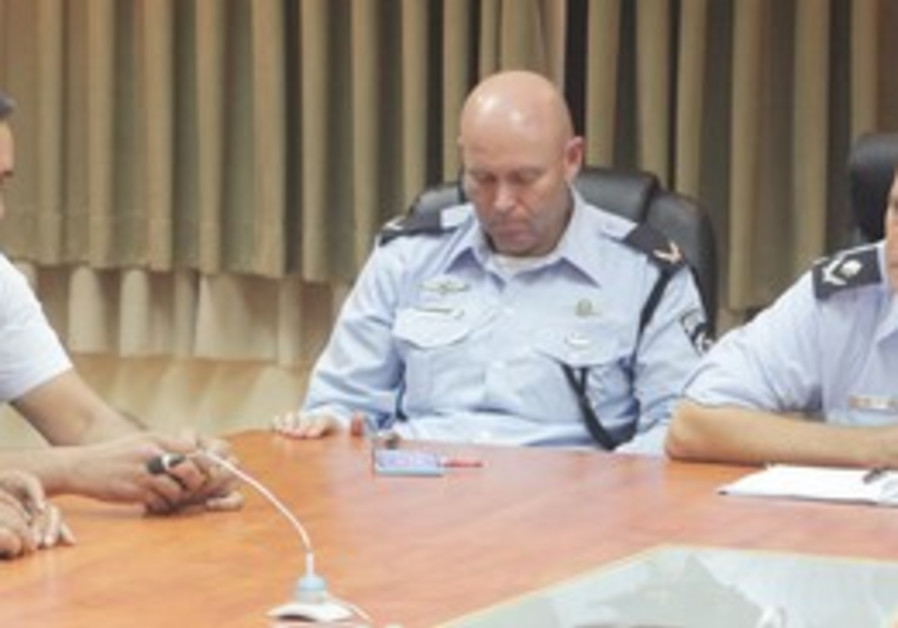 CMDR. YOCHANAN DANINO (right), head of the Southern District police, and Lt.-Cmdr. Avshalom Peled (s