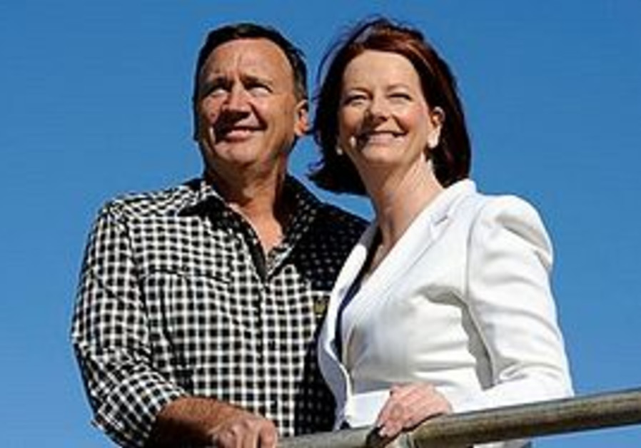 Australian Prime Minister Julia Gillard, right, leader of the Australian Labor Party, smiles with he