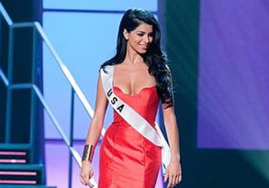 Rima Fakih, Miss USA 2010, poses for the judges in an evening gown of her choice during the 2010 Mi