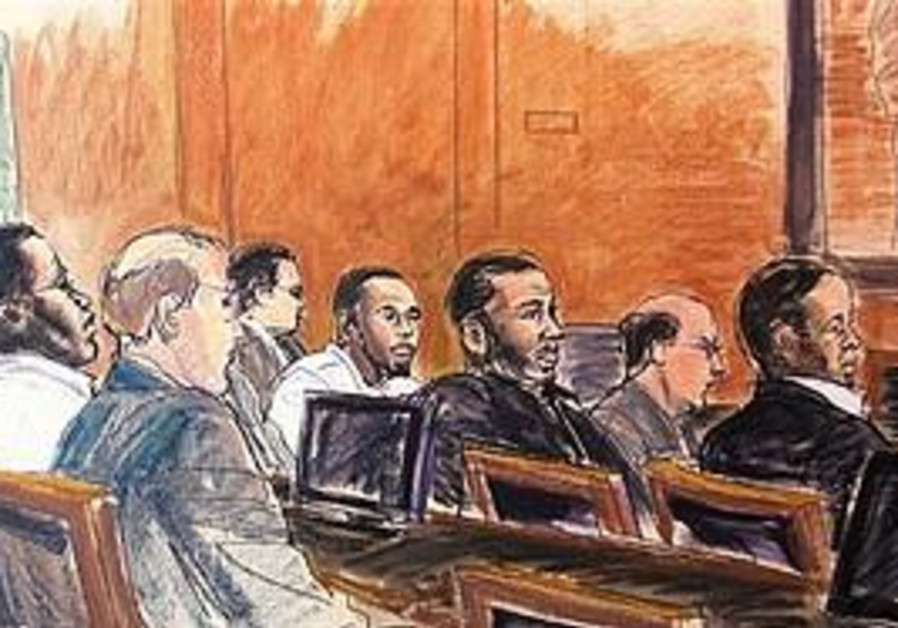 A courtroom sketch of the defendants and their attorneys