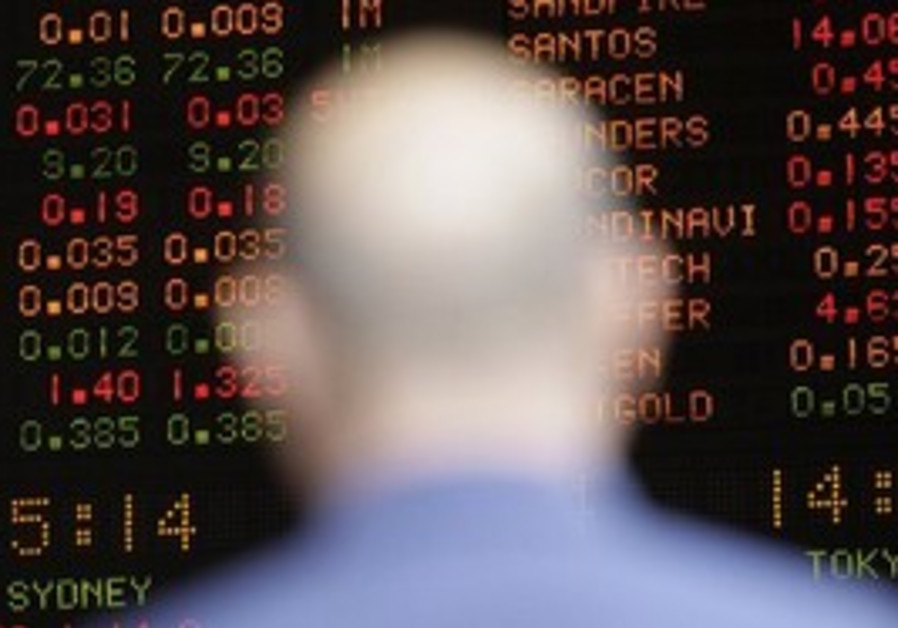 A man stands in front of a display board at the Australia Stock Exchange in Sydney Monday, Aug. 23,