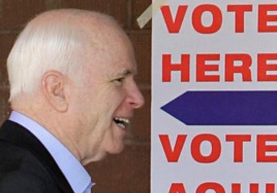 US Sen. John McCain, R-AZ., leaves his polling station Tuesday, Aug. 24, 2010 in Phoenix after casti