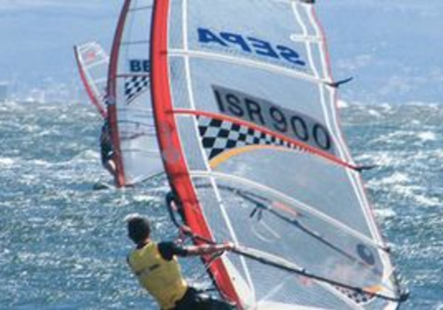 Mayan Rafic claiming gold in the Youth Olympics windsurfing category.