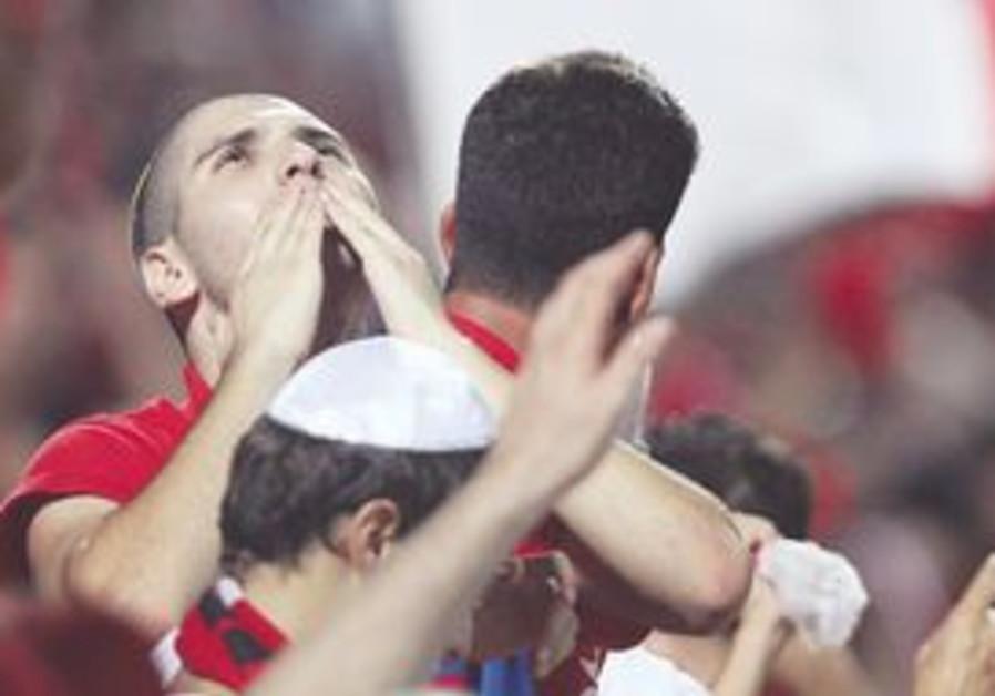 Hapoel Tel Aviv fan with kippa.