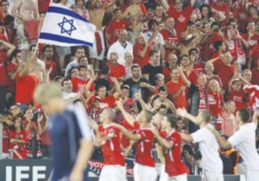Hapoel Tel Aviv fans at Bloomfield Stadium.