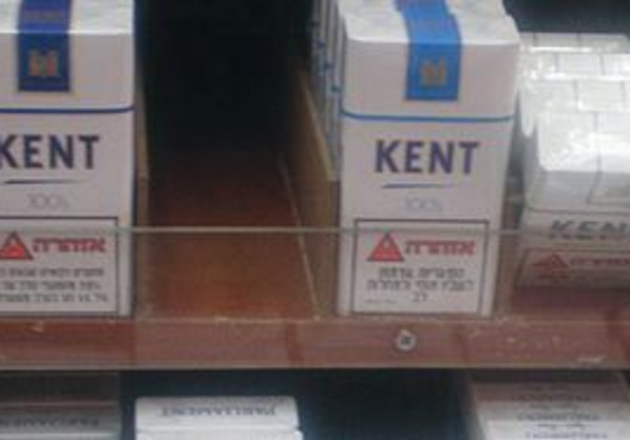 Packs of cigarettes for sale at a kiosk.