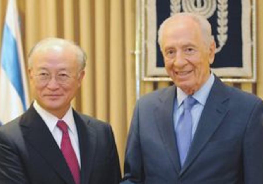 President Shimon Peres hosting IAEA head Yukiya Amano