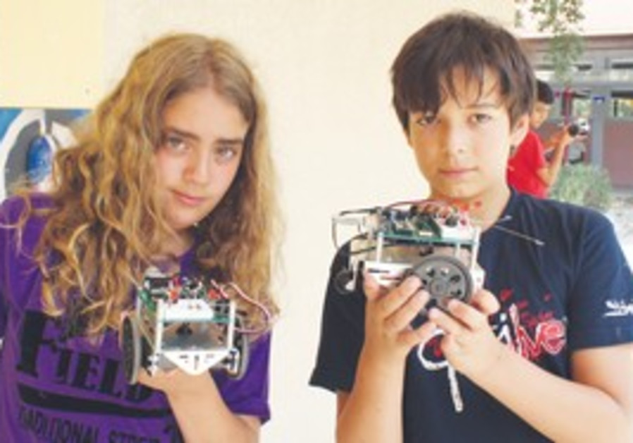 TRANSFORMERS. Campers show off robots they assembled and programmed themselves.