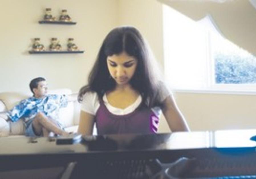 NIKITA DESAI of Sacramento, California, practices the piano for an upcoming recital. Desai has start