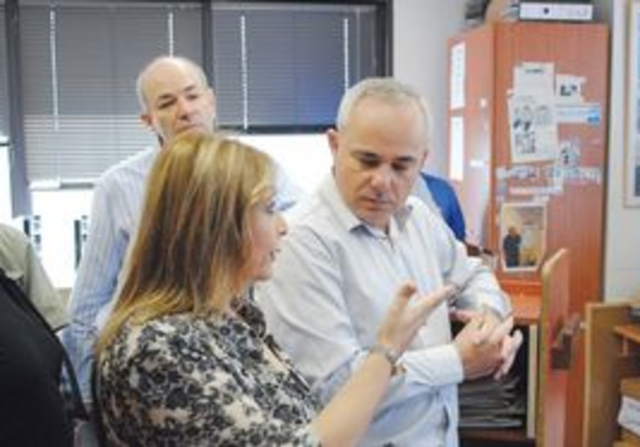 FINANCE MINISTER Yuval Steinitz listens to Authority for the Rights of Holoca