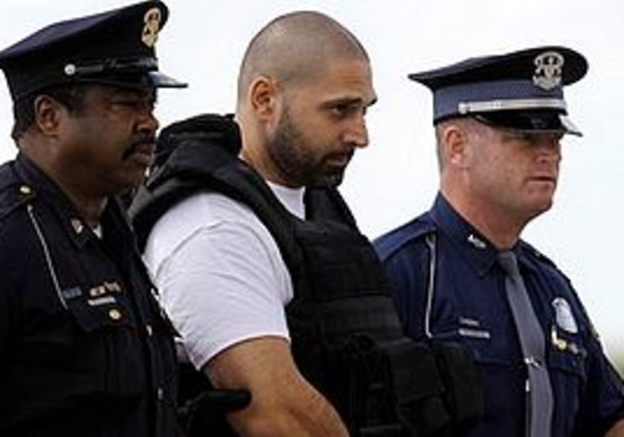 Alleged serial killer Elias Abuelazam is escorted by authorities after arriving on a flight in Flint