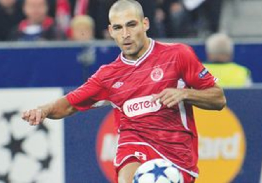 ITAI SHECHTER and his Hapoel Tel Aviv teammates will kick off the Champions League group stage in Se