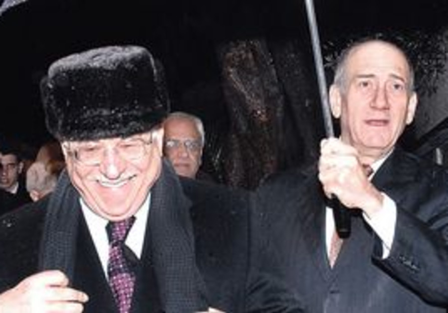 THE LAST TIME. The PA chief (with Olmert two years ago) has frittered away the past nine months, whe