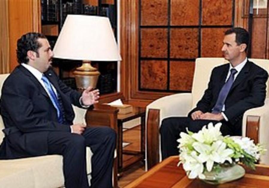 Syrian President Assad and Lebanese PM Hariri