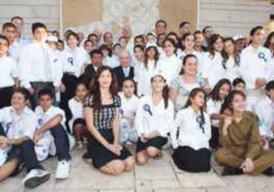 PRESIDENT SHIMON PERES sits with bar and bat mitzva boys and girls, and other victims of terror, at