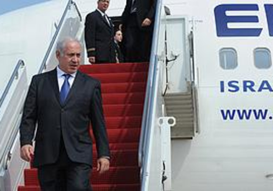 Netanyahu disembarking from a plane