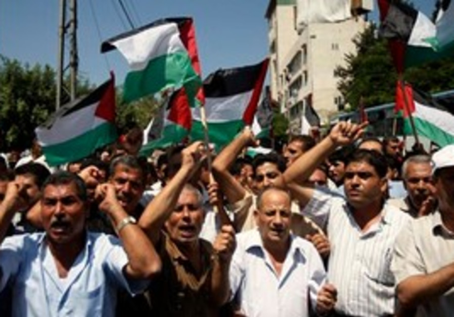 Palestinians  chant slogans as they attend a rally
