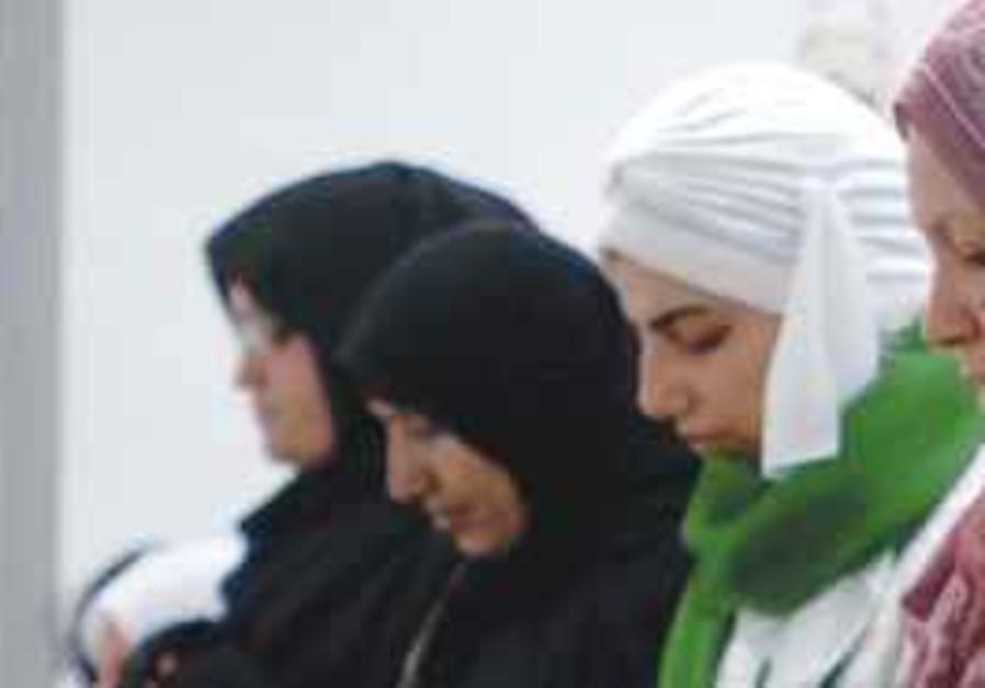 WOMEN PRAY at the Islamic Society of Colorado Spri