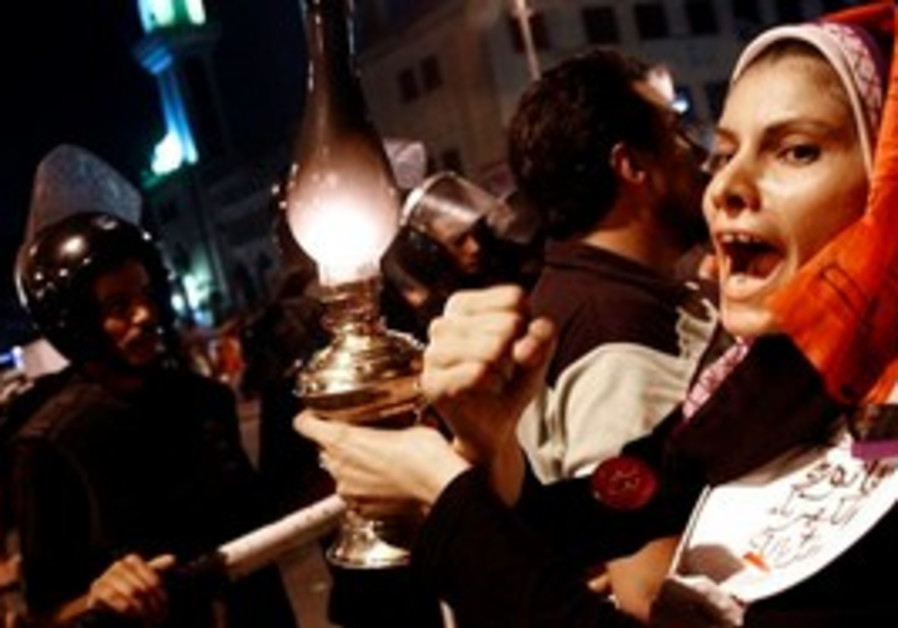 An Egyptian in Cairo protests power outages.