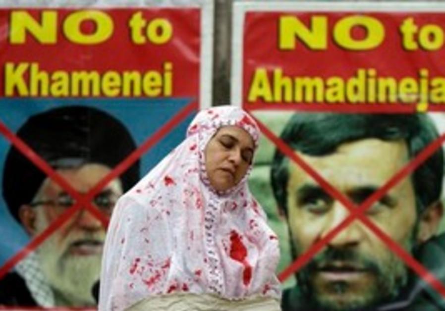 Woman protests Iranian human rights violations