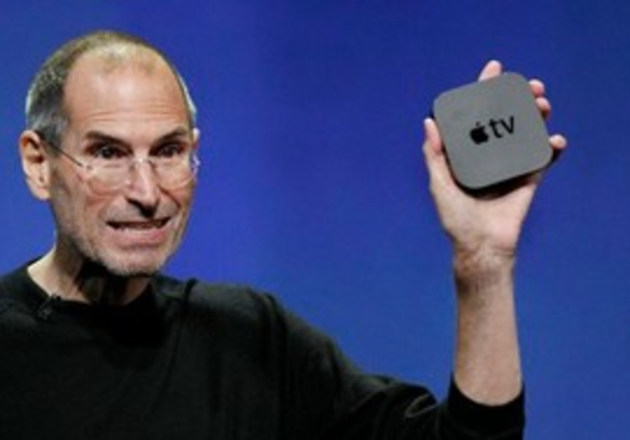 Apple CEO displays the new Apple TV.