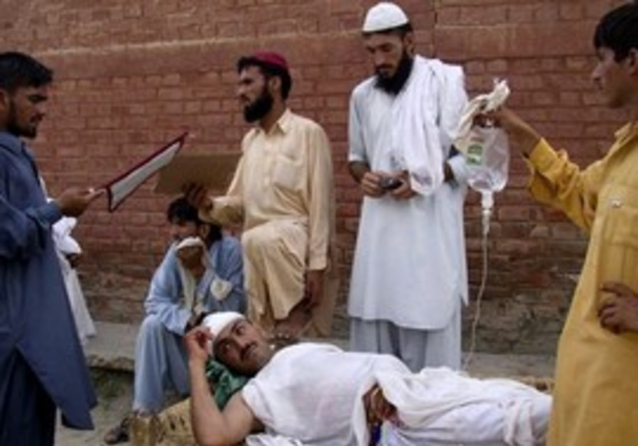 Man fans relative wounded in suicide bombing.