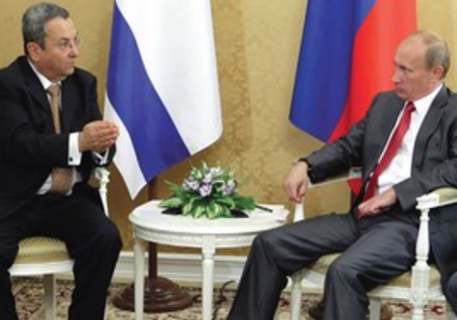 Ehud Barak and Vladimir Putin in Sochi, Russia.