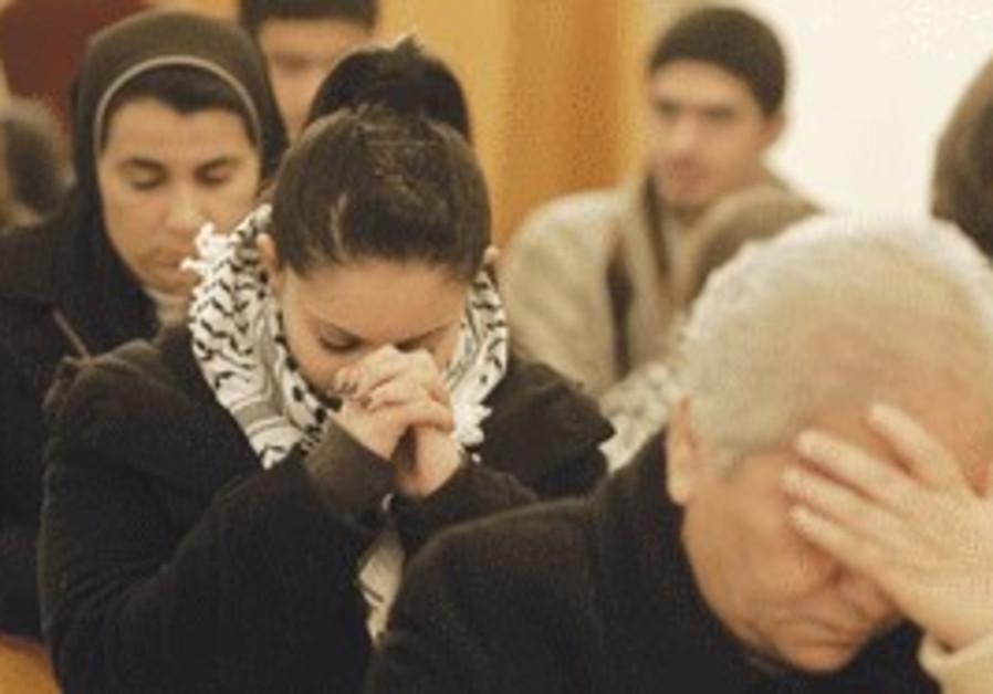 ARAB CHRISTIANS praying in a Gaza church