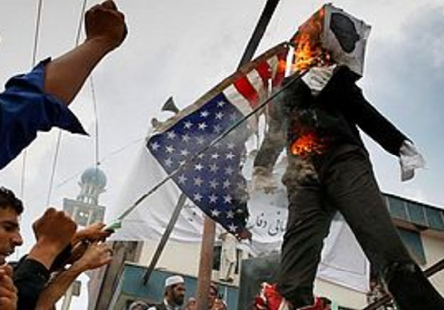 Protesters in Afghanistan burn an American flag