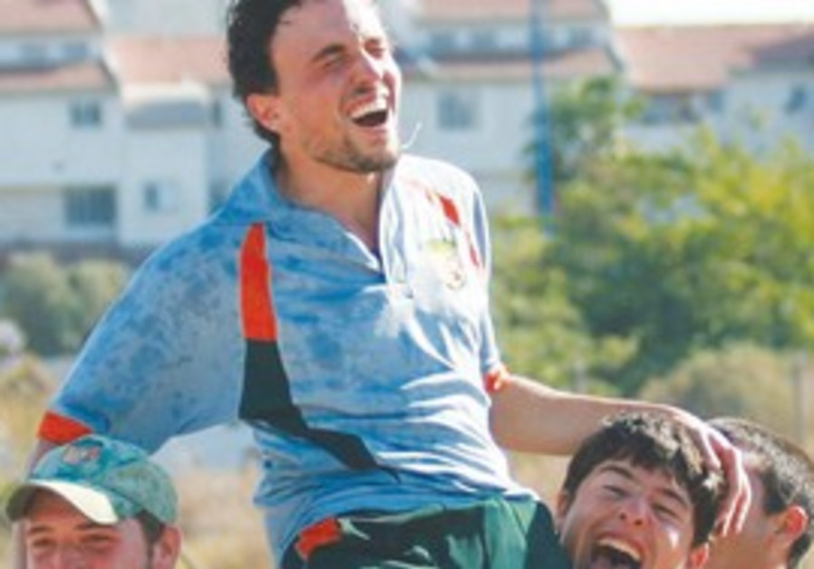 RA'ANANA PLAYERS celebrate after their title-clinc