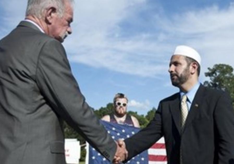 Terry Jones shaking hands with Muhammad Musri.