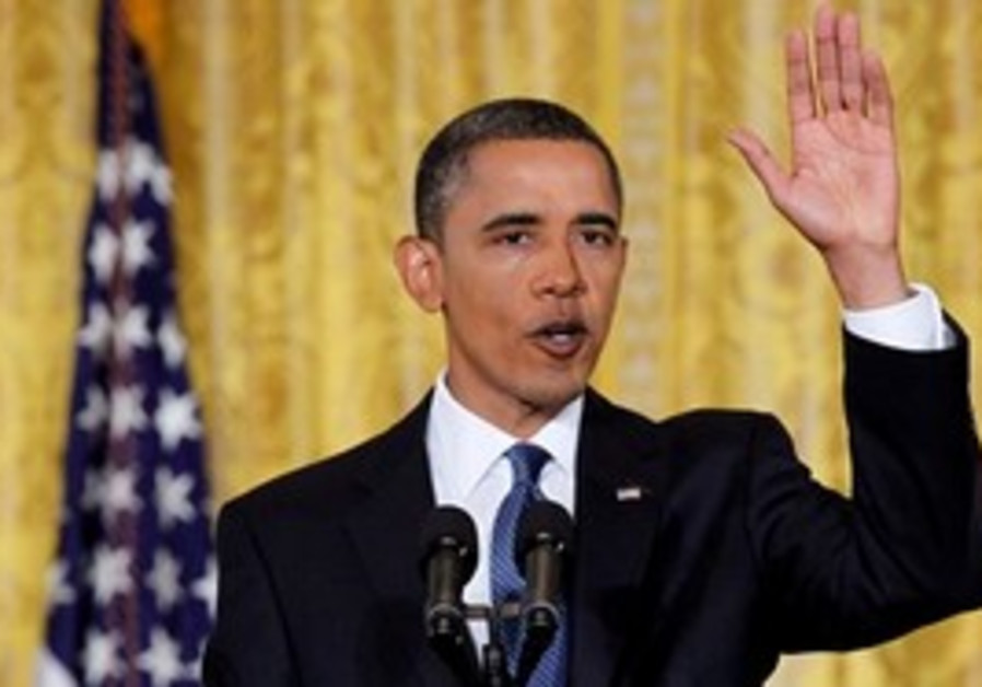 Obama  gestures at White House news conference
