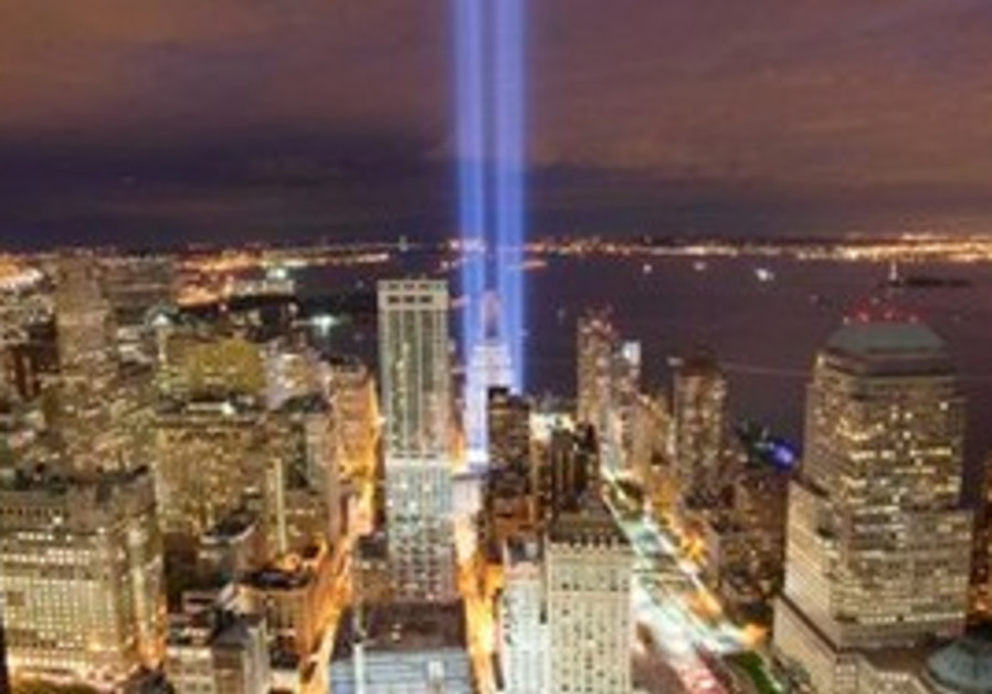 The Tribute in Light shines above the World Trade