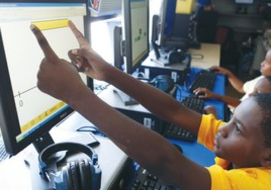 ONLINE EDUCATION: Deiontai Gordon, 10, works on an