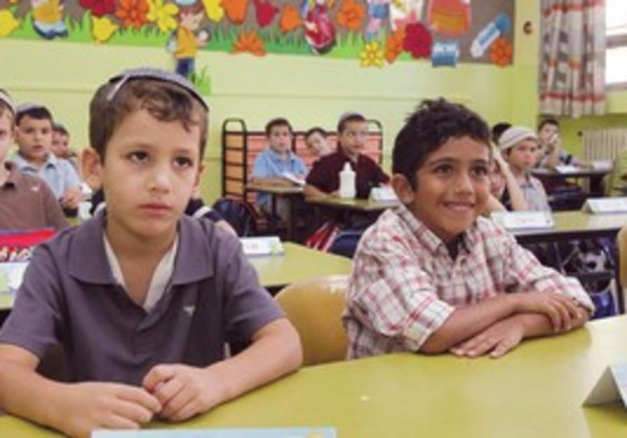 JERUSALEM BOYS start first grade at a local school