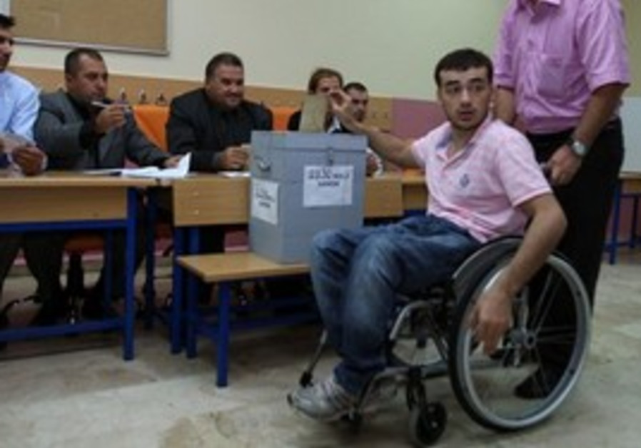 Turkish man in wheelchair votes