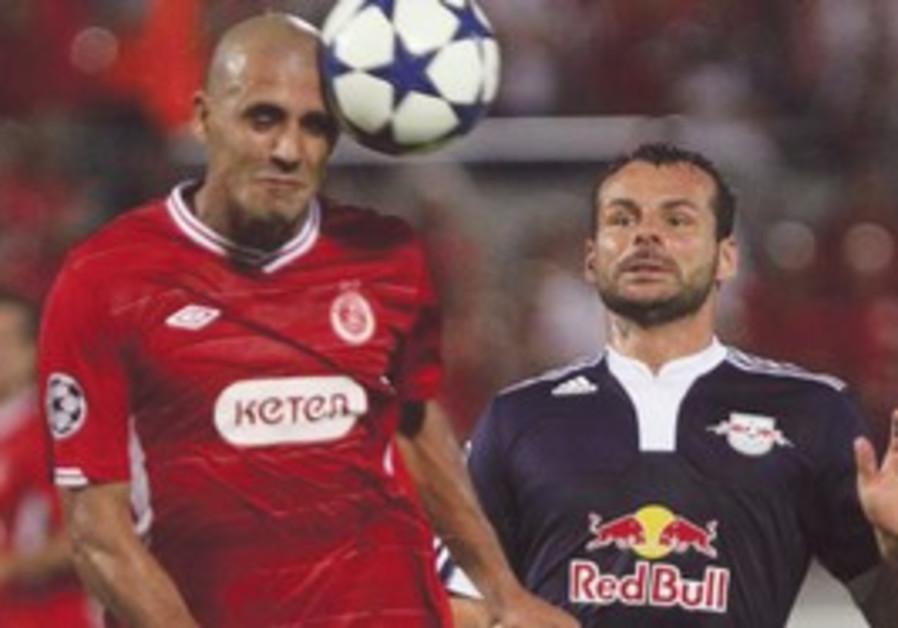 Hapoel Tel Aviv's Douglas da Silva heads the ball