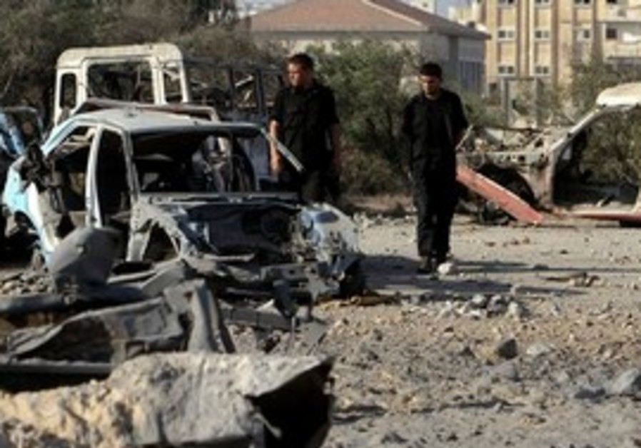 Palestinian Hamas officers inspect damage in Gaza