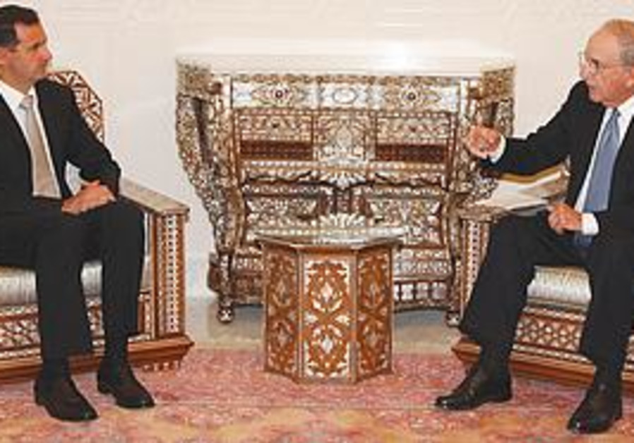 Syrian President Assad with US envoy Mitchell
