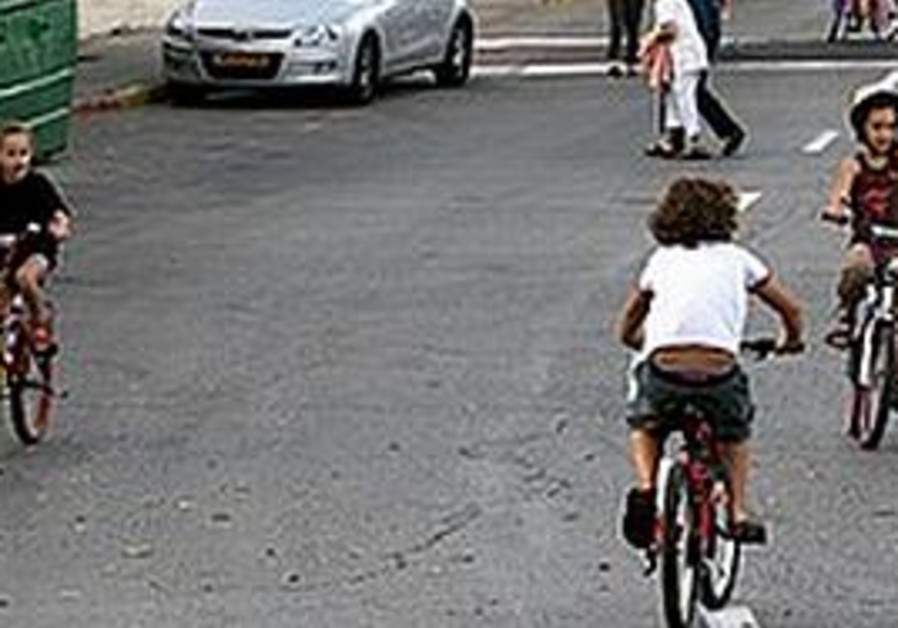 Children rides bikes on Yom Kippur