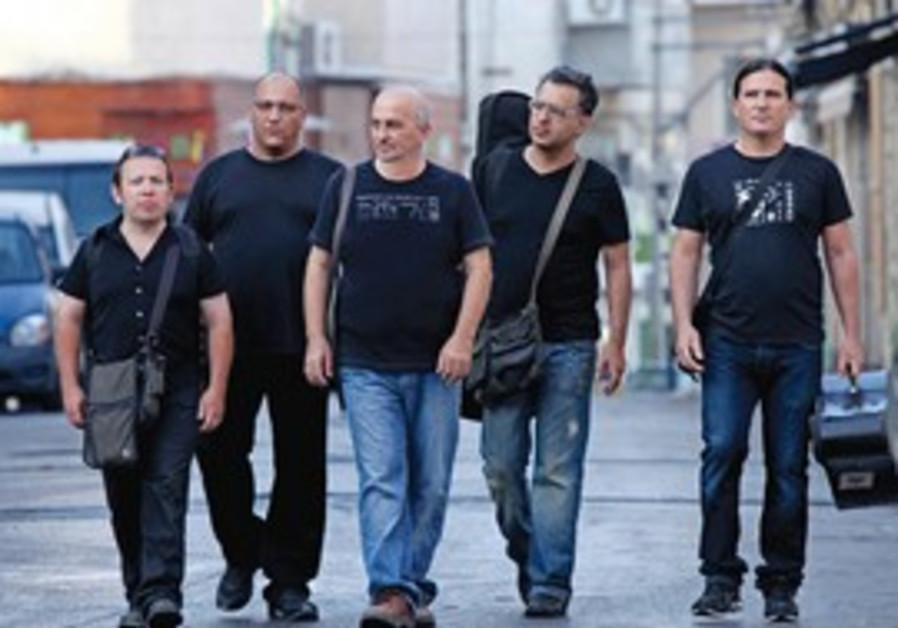 SHEM TOV LEVY (center) and his ensemble: 'We've al