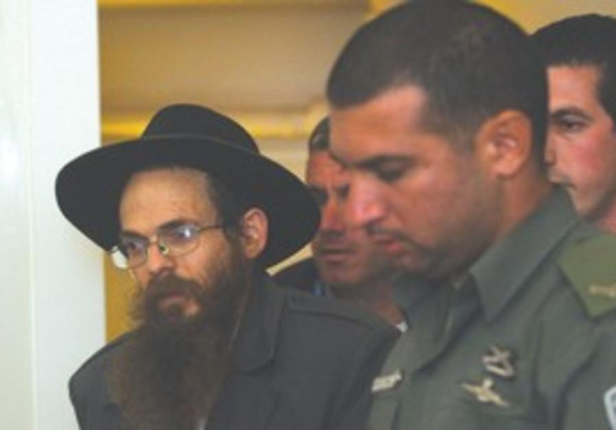 Rabbi Yitzhak Shapira handcuffed