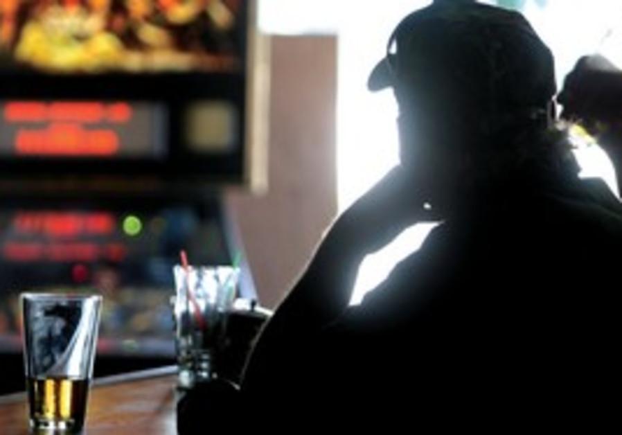 An alcoholic at a bar