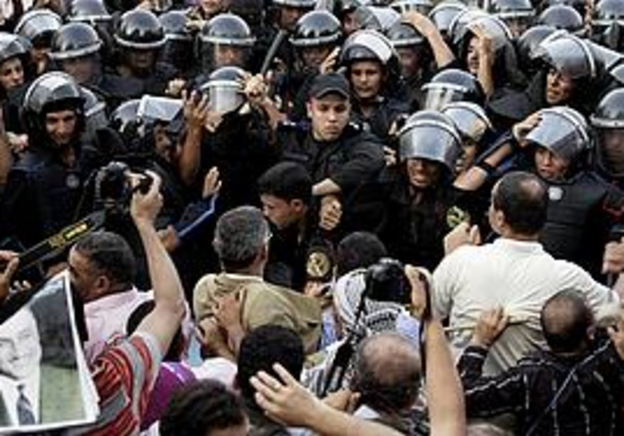 Riot police and protesters in Cairo