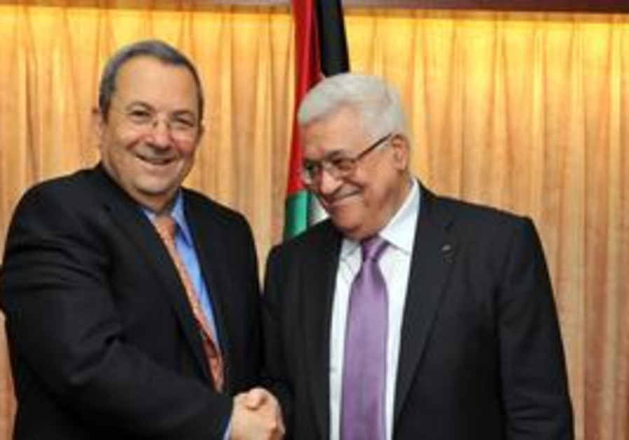 Ehud Barak and Mahmood Abbas shaking hands