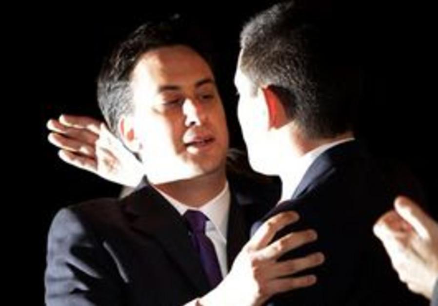 Ed Miliband, left embraces brother David Miliband