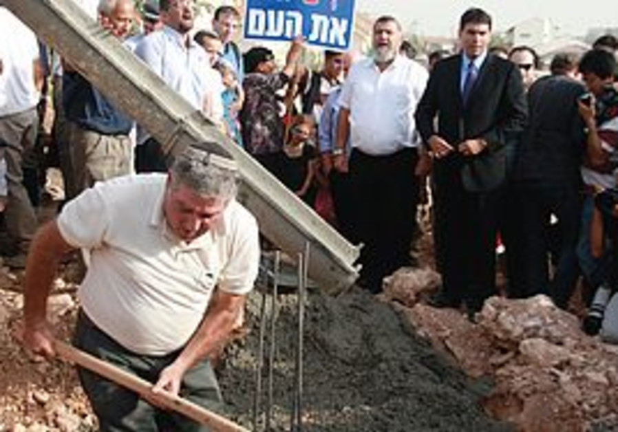SETTLERS POUR cement at the site of a planned nurs
