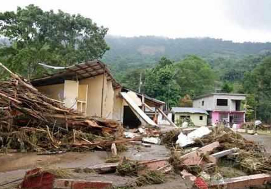 Debris from fallen trees and damaged homes