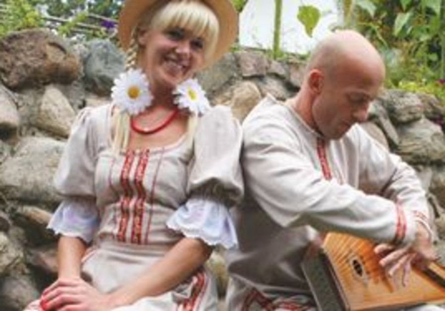 Oksana Salkovska with Valery playing a gusli