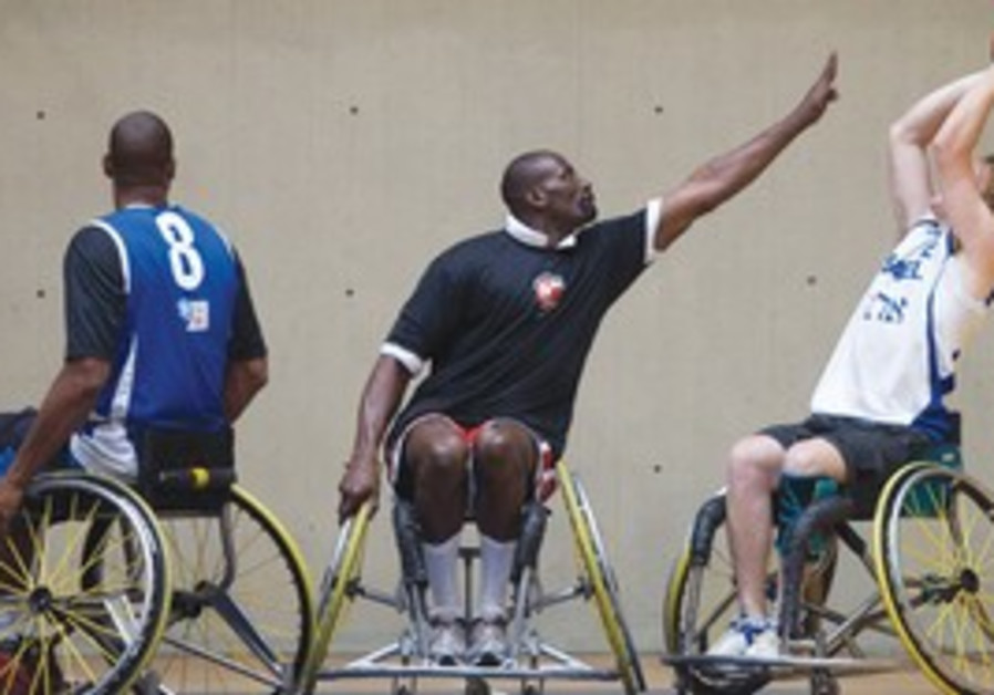 NBA players in wheelchairs visiting Israel.